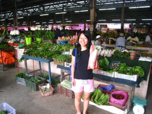 Happy posing in front of the pasar